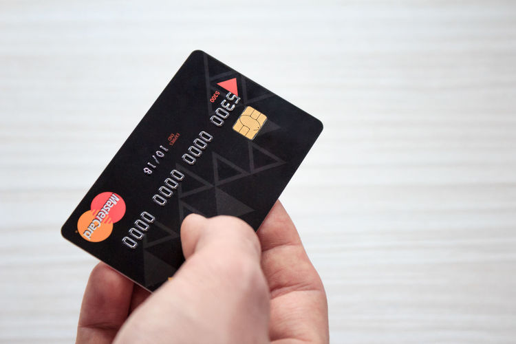 Human Hand Human Body Part Control Holding Wireless Technology One Person White Background Human Finger Money Costs Expenses Payment Making Money Business Finance And Economy Card Payment System Payments MasterCard Credit Card Banking Shopping Time Onlineshop
