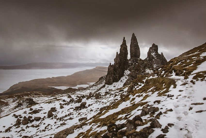 By looking at the picture you can tell that the weather conditions were far from perfect for a walk up to the old man of storr on the isle of Skye. It was already raining when we started the hike, but we were short on time and there was no coming back to this location. So we went up there.. Halfway to the top and shortly after this pic was taken, a freaking hail storm chrashed down on us. Frightening experience it was! We decided to go back, approaching the summit was too dangerous under these conditions... The Weather was just going nuts at the time we were there. Even the locals were quite speechless... Well, at least I got rewarded with some nice moody pictures :) The Adventure Handbook Open Edit Nature The Great Outdoors - 2015 EyeEm Awards Beautiful Nature EyeEm Best Shots - Nature Wanderlust Exploring Hiking Hikingadventures Hiking Trail Snow ❄ Freezing Old Man Of Storr Skye Landscapes With WhiteWall Original Experiences on Isle Of Skye Scotland