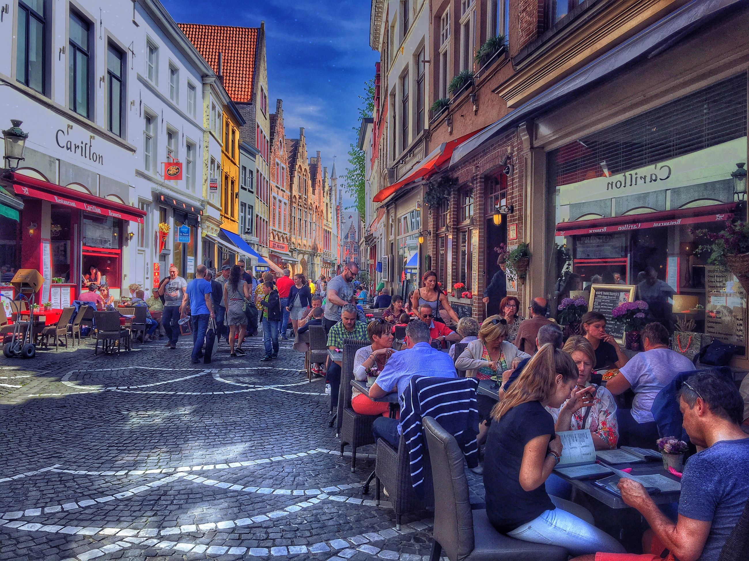 building exterior, architecture, built structure, lifestyles, men, leisure activity, person, large group of people, street, city, city life, illuminated, casual clothing, crowd, building, walking, celebration, outdoors, residential building