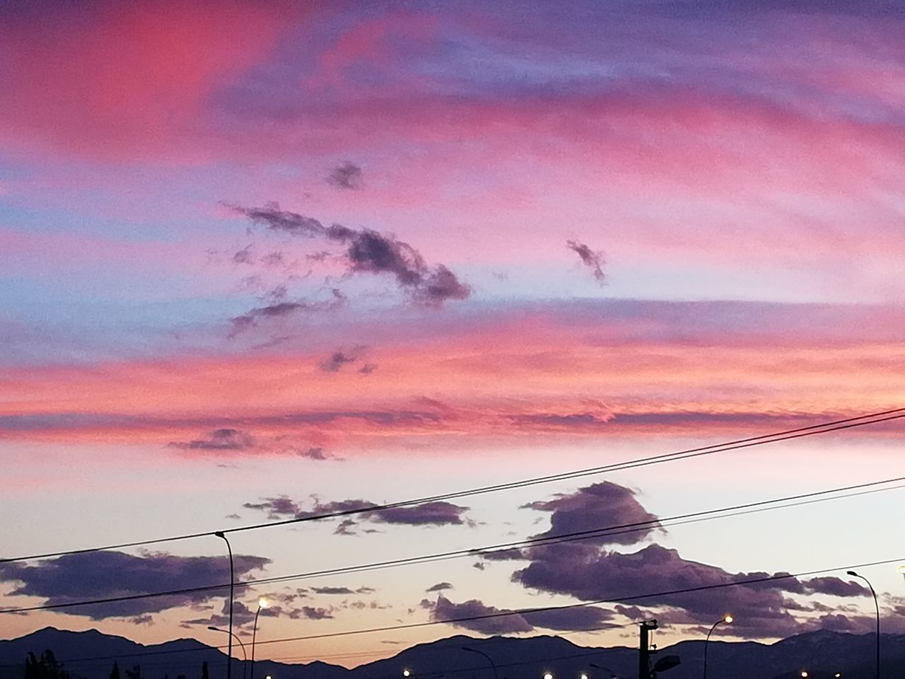 sunset, sky, cloud - sky, nature, beauty in nature, no people, scenics, outdoors, silhouette, mountain, cable, animal themes, electricity pylon, vapor trail, bird, day, mammal