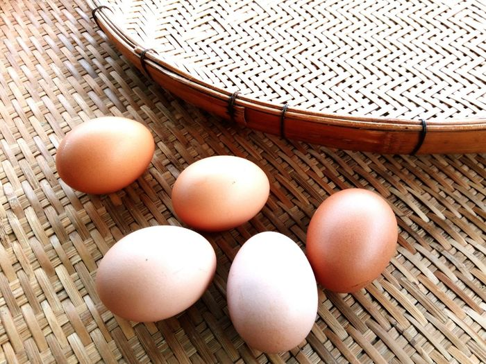 Fresh eggs on the wooden threshing basket Arrangement Decoration Kitchen Bamboo Basket Threshing Basket Protien Food Indoors  EyeEm Selects Egg High Angle View Brown Healthy Eating No People Food Indoors  Egg Carton Day Close-up Freshness Egg Yolk