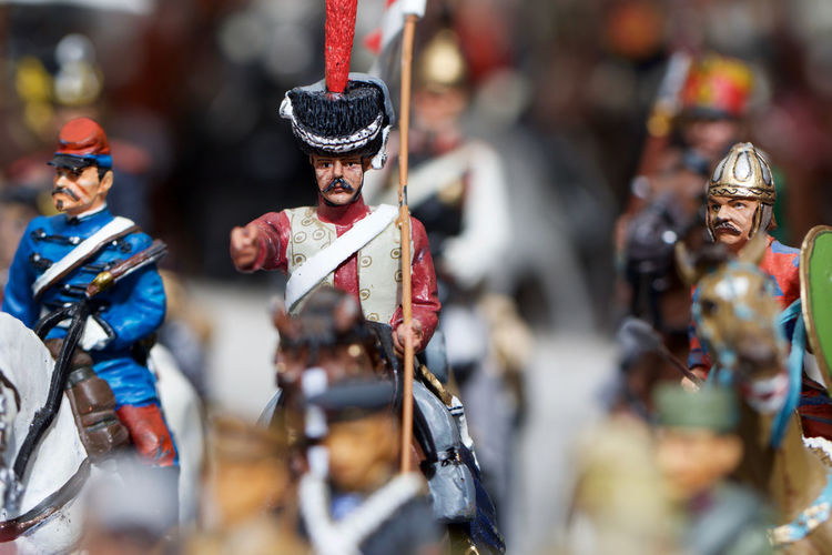 Close-up of figurines against blurred background