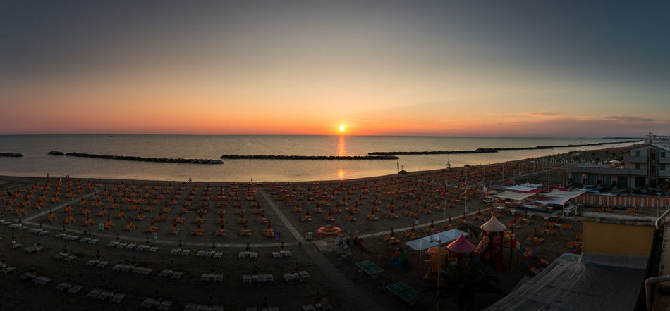 Sunrise panorama on the beach of Torre Pedrera at Rimini in Italy Sunset Water Sky Sea Horizon Over Water Nature Horizon Scenics - Nature Beach Orange Color Land Sun Architecture High Angle View Cloud - Sky Beauty In Nature Travel Destinations Outdoors Transportation Adriatic Sea Sunrise Panorama Beach Lounger Torre Pedrera Holiday