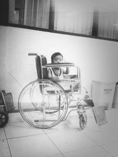 sitting in a wheelchair...