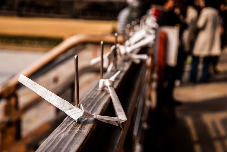 Close-up of paper on railing