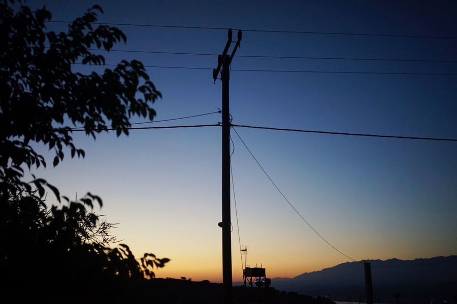 Sky Electricity  Cable Sunset Electricity Pylon Power Line  Silhouette Technology Connection Power Supply Nature Tree No People Plant Low Angle View Outdoors Tranquility Scenics - Nature