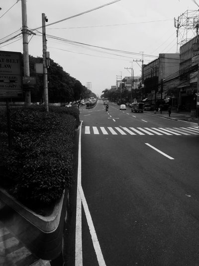 City Streets in Morning Road Marking Road Transportation Day Electricity Pylon Cable IPhoneography Architecture Built Structure Sky No People Road Sign Tree City Nature