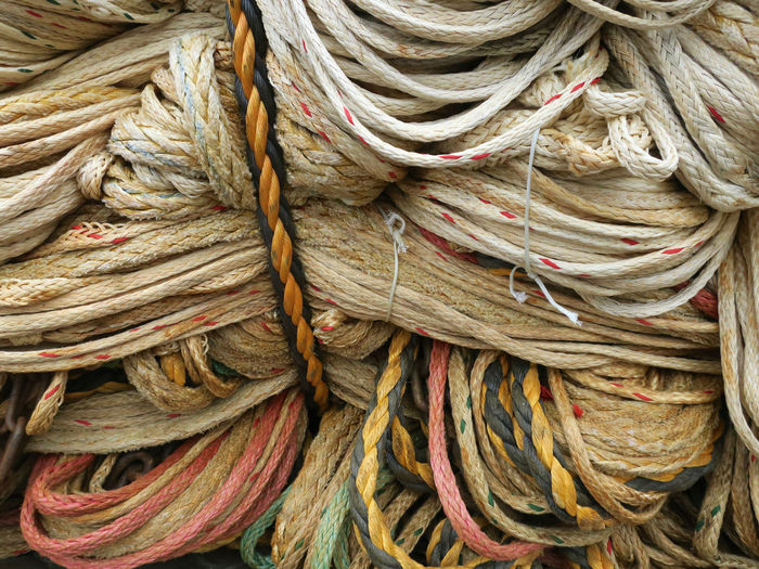 bunch of ropes Fishing Net Backgrounds Close-up Complexity Day Focus On Foreground Full Frame High Angle View Large Group Of Objects No People Pattern Rope Stack Still Life Strength String Textile Textured  Tied Knot Tied Up Twisted