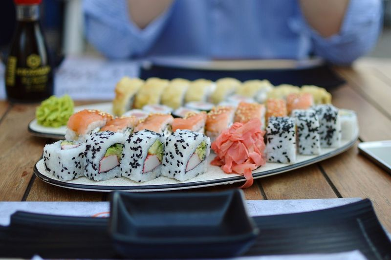 Close-up of sushi served on restaurant table