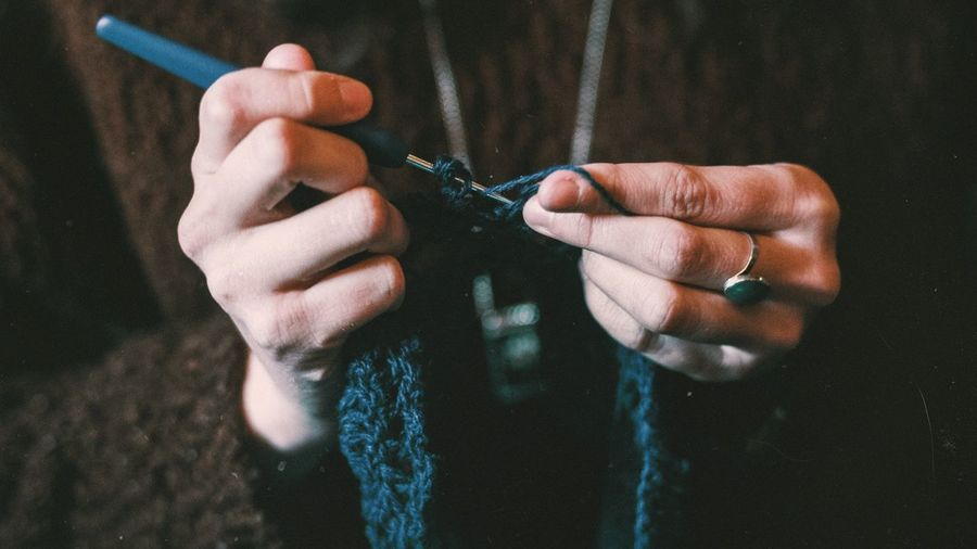 Close-Up Of Women Knitting Wool