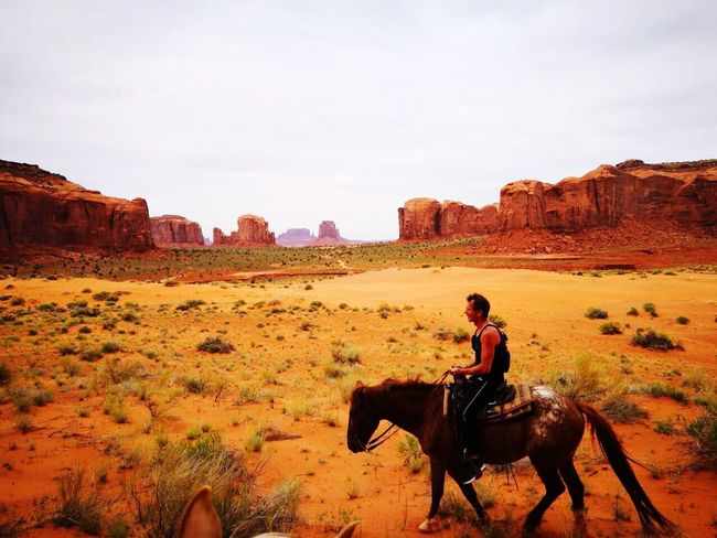 Horse riding through Monument Valley like John Wayne. Horse Horseback Riding Riding Rock - Object Domestic Animals Wild West Adult Nature Landscape One Person People Outdoors Full Length Desert Women Only Women Young Adult Sky Day Mammal Monument Valley John Wayne Arizona Navajo USA