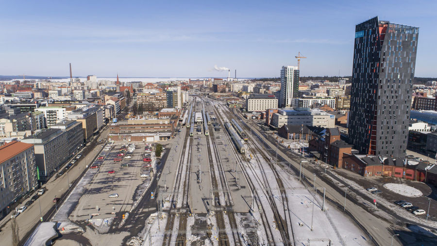 High angle view of railroad tracks amidst buildings in city