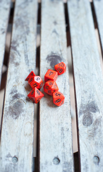 Red dices on wooden table