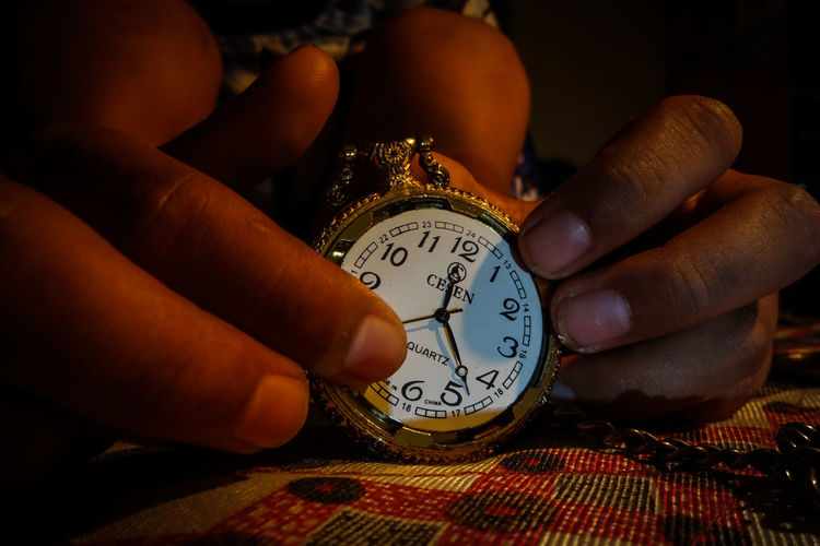 Time..... its just number but important 10 Accuracy Body Part Clock Close-up Finger Focus On Foreground Hand Holding Human Body Part Human Finger Human Hand Indoors  Lifestyles Minute Hand Number One Person Pocket Watch Real People Time Unrecognizable Person Watch