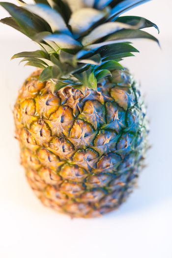 pineapple isolated on white background Pineapple Healthy Eating Studio Shot Wellbeing Tropical Fruit Indoors  Food Freshness Close-up Fruit Green Color Plant White Background Nature Plant Part Leaf Single Object Ripe Isolated Vertical Raw Diet Healthy Sweet Snack Organic Juicy Fresh Closeup Natural Vitamin Exotic Yellow Vegan Ingredient Whole Detail Tasty Juice Dieting Macro Nutrition Delicious Antioxidant Blurred