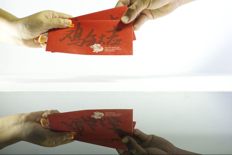 Ang Pao! Ang Pao Give Angpow Giving Money Hands White Background Culture Chinese New Year Tradition Chinese Indoors  Ang Pows Money Red Angpow Close-up Relections Human Hand Human Body Part
