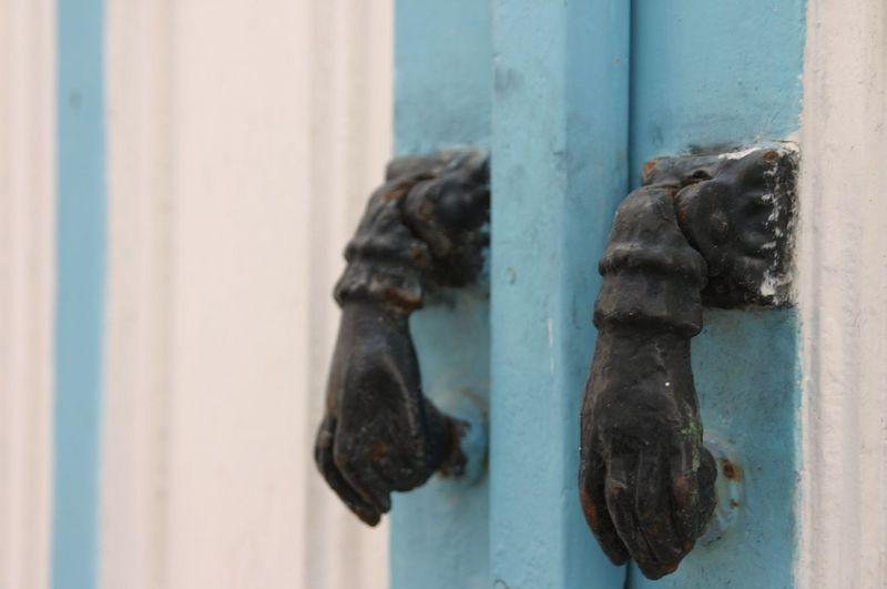 Close-up of rusty metal door knocker