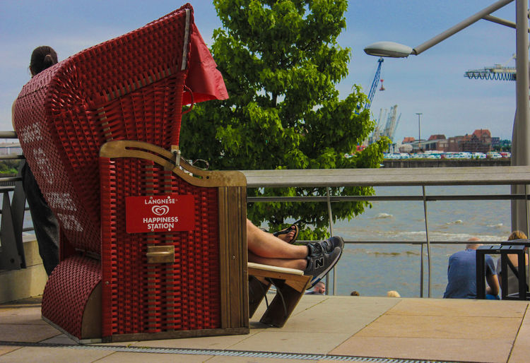 Global chilling Relaxation Red Chair Vacations People Streetphotography Sunny☀ Summer Hamburg Hafencity Lagnese Icecream