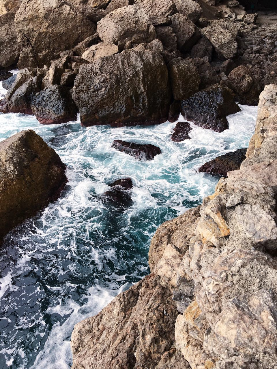 rock, rock - object, solid, water, beauty in nature, motion, rock formation, sea, nature, scenics - nature, day, no people, land, sport, aquatic sport, outdoors, high angle view, tranquility, power in nature, flowing water, flowing, rocky coastline, eroded