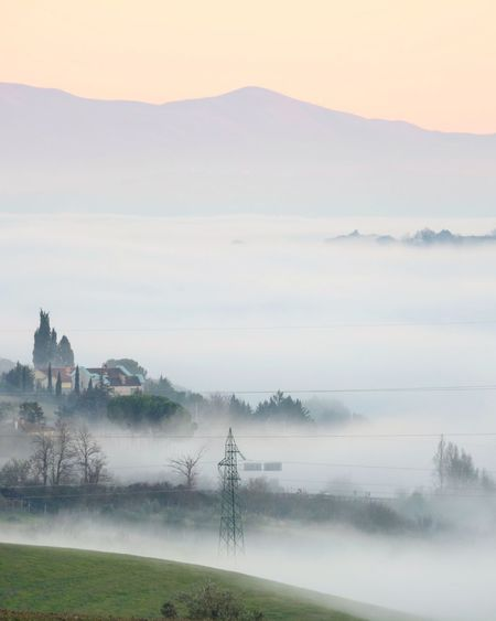 Low clouds. Nature No People Sky Tree Landscape Fog Beauty In Nature Tranquil Scene Tranquility Outdoors Tuscany Nature Mountain Beauty In Nature Sunset Cloud - Sky Silhouette Electricity  Electricity Pylon Tranquility Monteriggioni