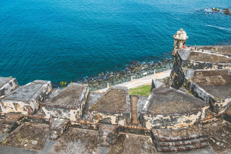 High angle view of stone wall in sea