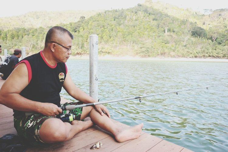 Mature man fishing in lake