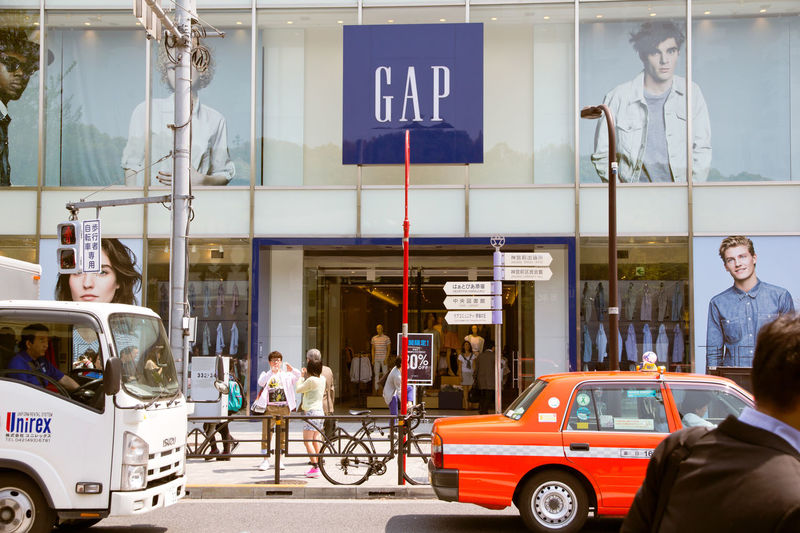 GAP Store in Harajuku, Pedestrians walk past the GAP Store in Harajuku on April 16, 2014 in Tokyo, Harajuku is known as a center of Japanese youth culture and fashion HarajukuCity Japan Japan Photography Shopping Tokyo Tokyo Street Photography Tokyo,Japan Adult Car Day Group Of People Land Vehicle Men Mode Of Transport Occupation Outdoors People Real People Retail  Retail Display Retail Store Standing Transportation Women