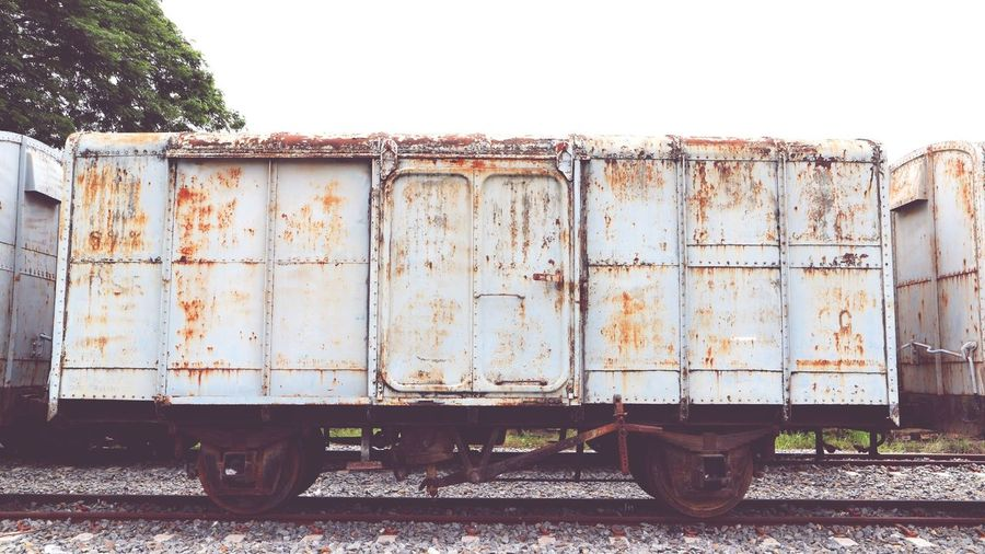 train Vintage Old Backgrounds EyeEm Best Shots EyeEm Selects Transportation Sky Rusty Peeling Off Peeled Discarded Damaged Moored Train - Vehicle Boat Nut - Fastener Latch Abandoned Freight Train Shunting Yard Deterioration Run-down Cargo Container Weathered Bad Condition Rail Transportation Railroad Track