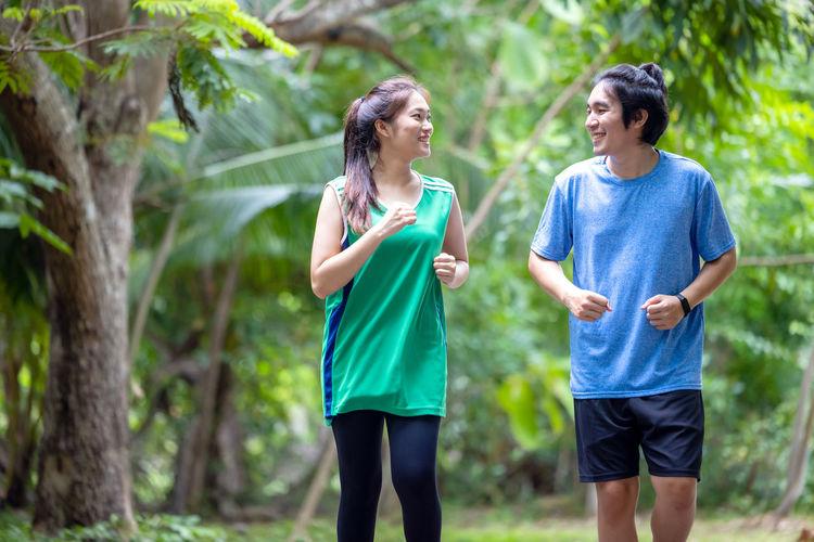 Rear view of women running