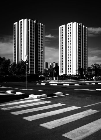 City Building Exterior Architecture Built Structure Road Road Marking Street Transportation Sign Building Tall - High Symbol Crosswalk Office Building Exterior Marking Sky Zebra Crossing City Life Crossing Nature Skyscraper Outdoors Modern Cityscape