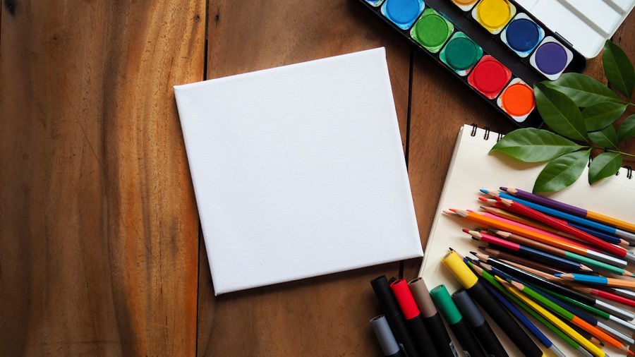 Place of work, blank white color paper page and colorful pencil on vintage wooden desk, creative graphic designer artist concepts for business and education background Sketchbook Book Pages Supplies Watercolor Watercolor Painting Workplace Drawing Drawing - Art Product Graphic Design Creative Designer  Design Artist ArtWork Art Art And Craft Equipment Large Group Of Objects Book Directly Above Publication Pen Craft High Angle View Creativity Blank Colored Pencil Still Life No People Indoors  Pencil Paper Wood - Material Art And Craft Table Multi Colored Writing Instrument Indoors