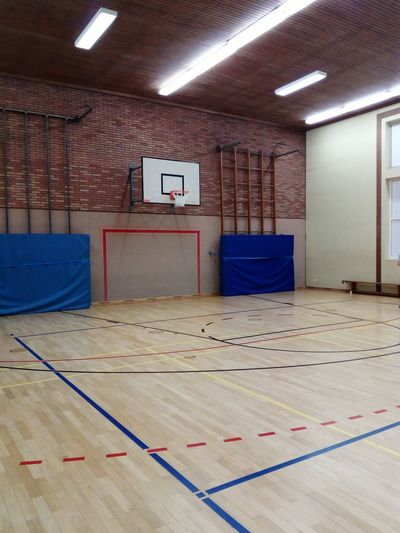 in a gym sports center Sports Center Playing Field Parquet Wooden Paneling Field Limit Field Line Limit Line Ball Sports Indoor Sports Indoors  Gym Built Structure No People Sport Architecture Day