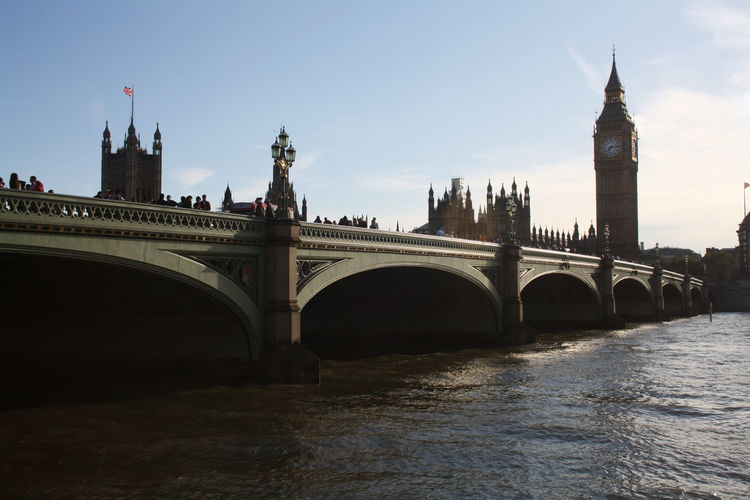 Low angle view of westminster bridge over river in city