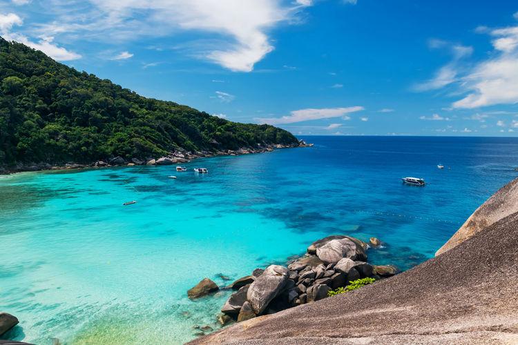 Aerial view of turquoise andaman sea and beautiful rock at similan island national park, phang nga