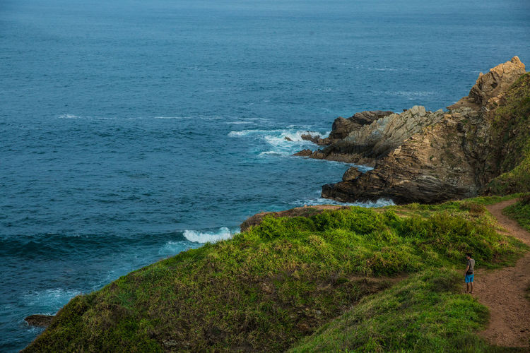 Beach Beauty In Nature Boarder Cliff Grass High Angle View Horizon Over Water Mexico Nature Oaxaca One Person Outdoors Rock - Object Scenics Sea Water