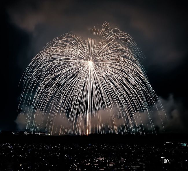 Night Long Exposure Motion Firework Display Exploding Firework - Man Made Object Blurred Motion Illuminated Event Sky Arts Culture And Entertainment Celebration Outdoors Firework Water No People Wire Wool こうのす花火大会