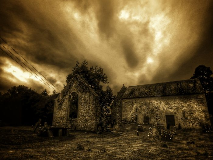 Taking Photos Check This Out From My Point Of View Ireland🍀 Graveyard Beauty Cemetery Built Structure Sepia/color Clouds And Sky Architecture Ancient History Old Church Gravestones And Monuments Cloudshapes Graveyard St Mochuas Tee Lane Graveyard Nature Eyeem2017 Trees And Leaves Light And Shadow Outdoors Dramatic Sky Enjoying The View