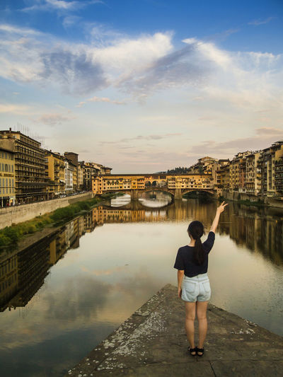 Rear View Of Woman Standing On Bridge Against Ponte Vecchio
