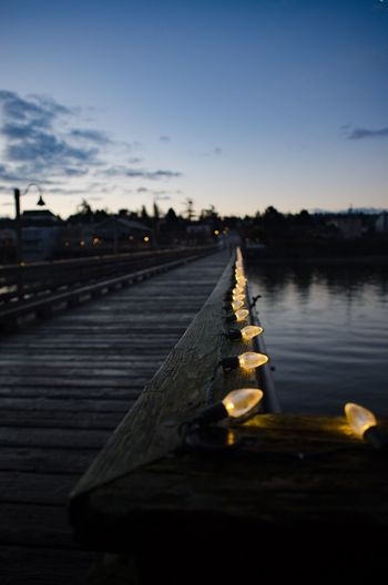Lights on the wharf at dawn. Illuminated Dusk In A Row Sky Diminishing Perspective Tranquil Scene Vanishing Point Focus On Foreground Tranquility The Way Forward Lit Non-urban Scene No People Surface Level Scenics