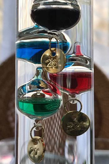 No People Indoors  Close-up Day Multi Colored Childhood Galileo Thermometers Technology Gold Colored Floating In Water Floating Bubbles Floating Thermometer Olden Days Thermometer Vintage