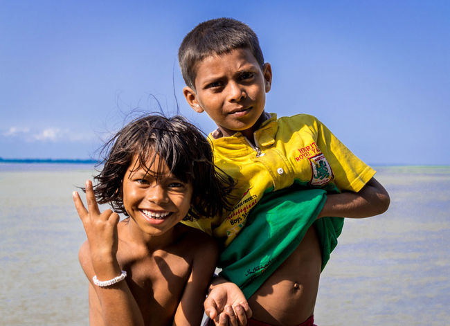 black vs white - a difference in perspective Girl And Boy Girl Boy Homeless Indian Subhamdasgupta Innocence Children Indian Children Victory Men Sea Bonding Cheerful Beach Family Bonds