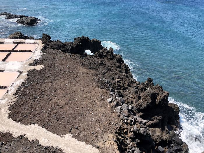 Sea Water Rock Beach Beauty In Nature Land High Angle View Rock - Object Nature Solid No People Day Wave Scenics - Nature Rock Formation Tranquility Motion Tranquil Scene Outdoors Rocky Coastline Breaking Salzgewinnungsanlage Felsenküste La Palma, Canarias