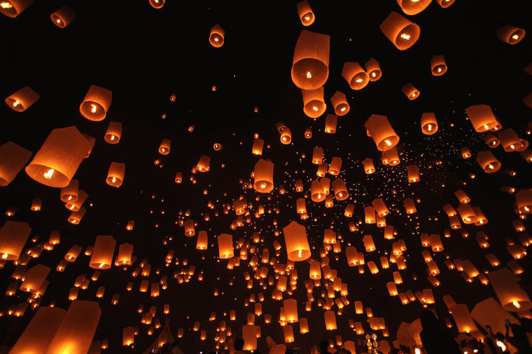 Low angle view of illuminated paper lanterns at night