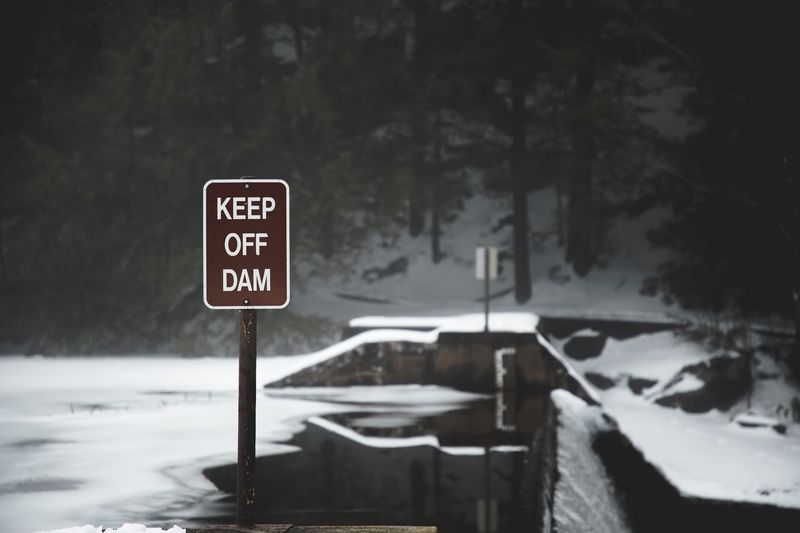Communication Text Snow Warning Sign Winter Nature No People Outdoors Cold Temperature Road Road Sign Close-up