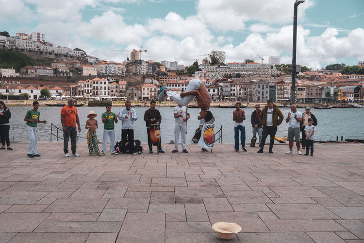 capoeira in Ribeira - Porto Adult Architecture Building Exterior Built Structure City City Life Cloud - Sky Crowd Day Group Of People Large Group Of People Leisure Activity Lifestyles Men Nature Outdoors Paving Stone Real People Sky Street Women The Traveler - 2018 EyeEm Awards The Street Photographer - 2018 EyeEm Awards