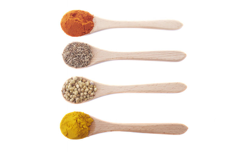Various herbs and spices in wooden spoons. Flat lay of spices ingredients chilli cumin seed coriander seed and turmeric powder on white background. Studio Shot White Background Indoors  Cut Out Food And Drink No People Variation Food Choice Spoon Freshness In A Row Ingredient Kitchen Utensil Wellbeing Close-up Directly Above Eating Utensil Group Of Objects Order