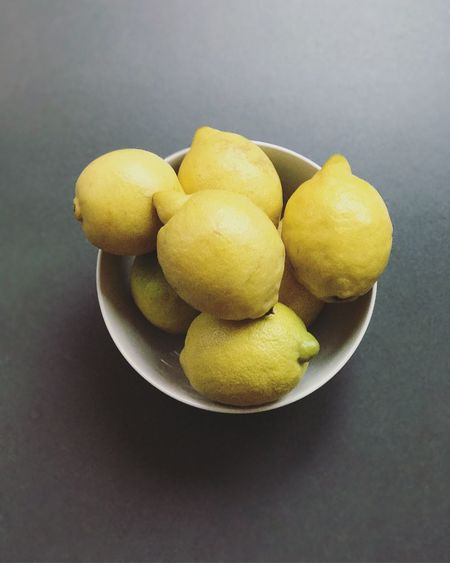 High angle view of fruits in bowl against black background