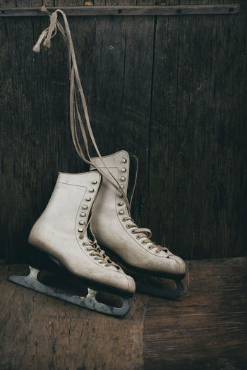 Close-up of ice skates hanging on wall