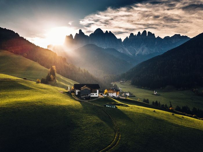 Mountain Sky Beauty In Nature Scenics - Nature Nature Landscape Plant Environment Grass Land Cloud - Sky Mountain Range Green Color Sunlight Field Sun Non-urban Scene Tree Tranquility No People Outdoors Lens Flare Aerial View Dolomites, Italy Drone  Capture Tomorrow
