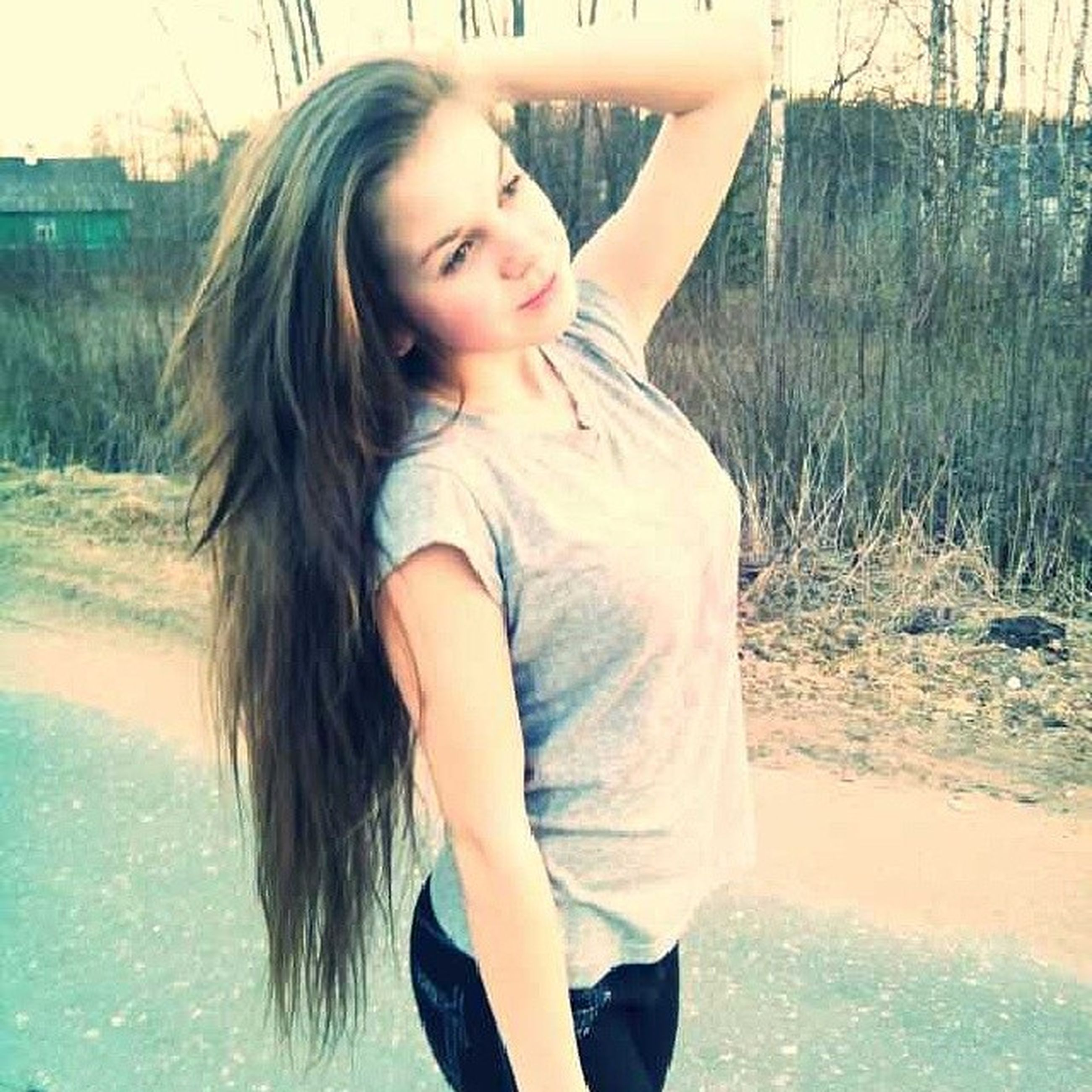 person, young adult, young women, long hair, lifestyles, leisure activity, water, portrait, looking at camera, smiling, casual clothing, blond hair, front view, happiness, three quarter length, standing, medium-length hair